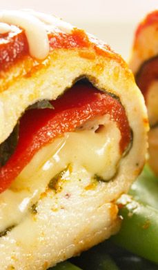 Chicken Mozzarella Roll-​Ups  Delicious mozzarella cheese, fragrant basil and roasted red peppers are rolled in tender chicken breasts and baked in tomato sauce.