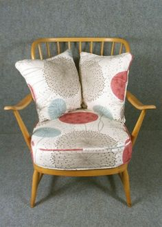 A high back 1950's Ercol chair in Harlequin Gardenia fabric