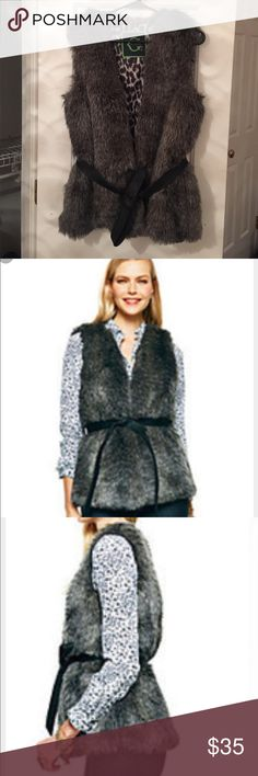 C. Wonder Gray Faux Fur Vest Charcoal gray faux fur vest with a black leather belted tie. Lined and in great condition with no damage to the fur or inner lining! C. Wonder Jackets & Coats Vests