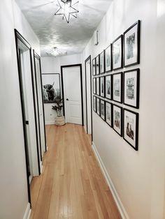 Decorating Stairway Walls, Narrow Hallway Decorating, Black And White Hallway, White Office, White Wall Bedroom, White Walls, Black Trim Interior, Cottage Hallway, Black Kitchen Countertops