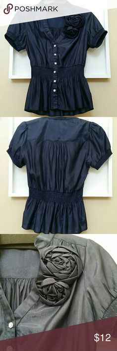 Navy blue blouse Nice blouse with a hint of shimmer. Nice buttons and rose detail on the left side. Elastic waist. In very good condition. Forever 21 Tops Blouses
