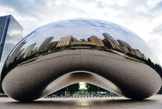 Cloud Gate is the centrepiece of the AT Plaza in Millennium Park, Chicago, and was designed by Indian-born British artist Anish Kapoor. The design of Cloud Gate was inspired by liquid mercury. The idea was that as visitors walked around the sculpture, its surface would act as a fun-house mirror and distort their reflections as well as that of the Chicago skyline. Computer modelling was essential in the engineering of its construction even though Kapoor does not draw with computers.
