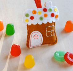 Gingerbread house ornament made of felt. Created by larkcrafts.com PDF file available with pattern and instructions. Looks like a great started sewing project