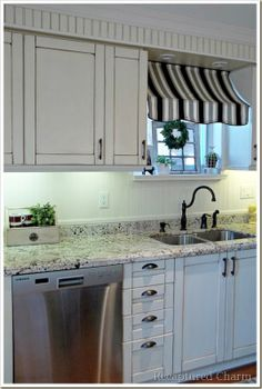 Awesome awning window treatment makes the kitchen look like a French bistro (@ Recaptured Charm)
