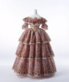 1855: ruffles were very popular as well as the natural floral pattern that was used in this