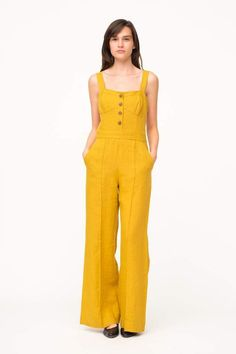 13038a2c40e This relaxed fit linen jumpsuit features front pleats