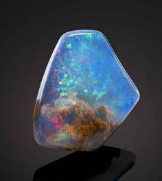 This is an American Contra Luz Opal.   This Beautiful Gemstone Looks Like It Contains A Small Nebula