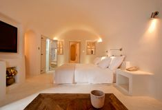 Kapari Natural Resort in Santorini is a smooth white wedding cake of a hotel, with contemporary cave-like rooms and cool neutral hues.