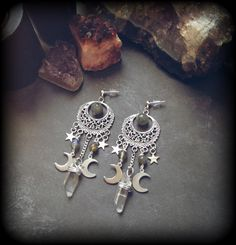 A handmade pair of earrings made from antiqued silver crescent moons with a…