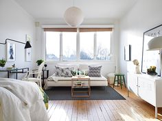 Bright and airy apartment in Sweden.    -->If I wind up in a studio apartment for intern year, this is an interesting floorplan/use of space.  I spy a CB2 locker0style credenza, probably cheapish DIY art and frames (could do with Kinko's and frrames from Michael's), and the light fixture is def. do-able on the cheap.  Like the pillows for a little punch of design-interest.