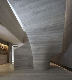 Jamie Fobert Architects, Private House, London, Travertine stair | In a project designed to merge two large apartments into a single home, the central feature was the creation of an opening between the floors with an elegant curved stair, carved from solid grey travertine.