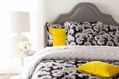 """Florence Broadhurst's pattern """"Japanese Floral"""" looks striking in black and white with yellow accent pillows from Surya. The bedding collection is available in two colors. (JFB-2002)"""