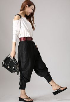 **Details** * Black linen pants * It has buttons in the front side * Two pockets on each side * It can adjustment with the string in the pants *