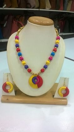 Colorful and vibrant jewelry set made with pink, blue, red and yellow silk threads wrapped around a base is both modern and classy design and golden beads are also used. This creation will surely add ethnic look to your attire and a flawless match to wear during festive season. #craftsofindia #indianhandicrafts #madeinindia #craftsbazaar #artsandcrafts #handmade
