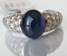 This beautiful vintage style true natural cobalt blue #Cabochon #Sapphire and #Diamonds Dome style ring crafted in 14K solid stamped White Gold is magnificent ! 1.93ct round brilliant cut Diamonds beaded set that are bright, sparkling and eye clean at VS2-SI1 clarity and F-G color. The ring face is takes near 1/2 of the way of mounting and it rise above the finger for 8mm. The ring size is 6.25 and the entire ring weighs 5.58 grams. $3,495