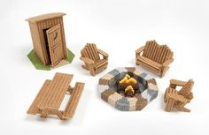 Includes fire pit, outhouse, 3 adirondack chairs and picnic.