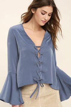 Drift away into a daydream with the Slip Away Slate Blue Long Sleeve Lace-Up Top! Silky, satin fabric forms this trendy blouse with a V-neck, lace-up front, and long bell sleeves. A relaxed bodice ends in a cropped, high-low hem.
