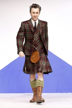 Actor Alan Cummings in what else, Cumming Hunting Weathered tartan day wear strides out at the Dressed To Kilt Show in New York, 2014