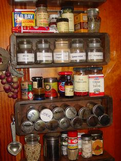 my spice shelves = antique sewing machine drawers!