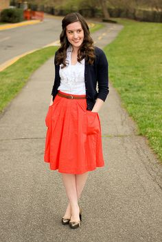 For short girls the perfect skirt length is mid-knee or over the knee