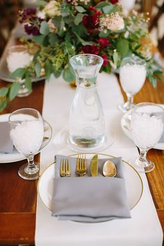 Table setting with gold-rimmed plate, grey napkin in pocket fold with gold flatware #cedarwoodweddings 10.28.17 :: Rachel + Joe | Cedarwood Weddings