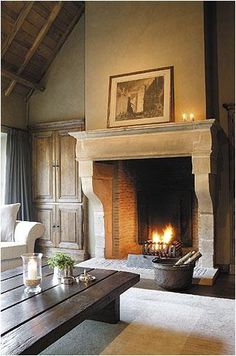 loving the fireplace and warm neutral colors...