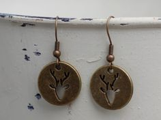 Antique Bronze Silhouette Deer Dangle Earrings by FoxCharmDesigns