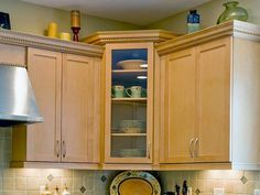 Corner kitchen cabinets allow you to make better use of an awkward space in your cooking area.