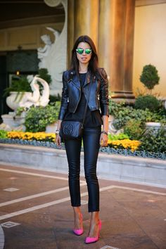 leather jacket with coated jeans and pink pumps