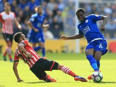 Southampton's Nathan Redmond slides in as Daniel Amartey braces himself for imminent contact after passing the ball