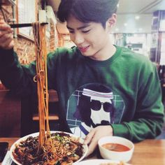 park bo gum is eating Ja-jang-myeon. (Korean style noodle)