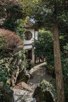 A small detached house in the garden outside a minka, or a traditional Japanese house, in Oiso near Tokyo. The steps lead down to an outdoor rotenburo bath.