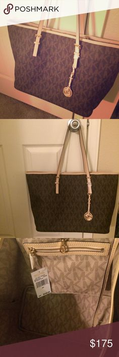 """Michael Kors Jet Set Travel Tote Michael Kors Jet Set Travel Tote Brown medium MK Signature 38S6GTVT2B  NWT (MK tag and care card attached) -MK Signature PVC; lining: polyester -Double handles with 8-1/2"""" drop, 11"""" tall x 20"""" wide -Exterior features 18k gold-plated hardware -Interior features key lanyard and side zip pocket Michael Kors Bags Totes"""