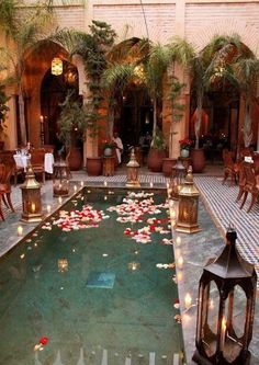 Marrakech pool adorned with customary wedding decor of brass lanterns, luminous . - Marrakech pool adorned with customary wedding decor of brass lanterns, luminous candles, and floati - Oriental Wedding, Moroccan Wedding, Moroccan Style, Moroccan Design, Modern Moroccan Decor, Moroccan Garden, Moroccan Bathroom, Moroccan Theme, Moroccan Interiors