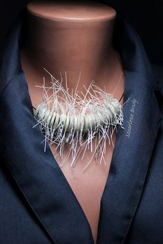 Marlene Brady. Textile beads - polymer clay, cotton lace and cotton thread.