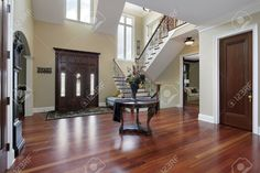 Foyer in luxury home with cherry wood flooring Stock Photo - 23889075