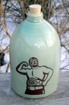 luchador mezcal jug ceramic handmade by MoonshineJug on Etsy https://www.etsy.com/listing/190240014/luchador-mezcal-jug-ceramic-handmade