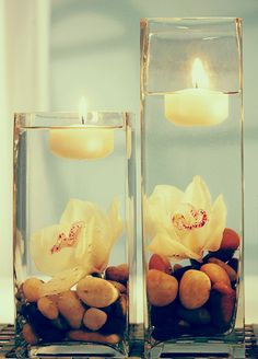 Do you see how easy this one is too?  Stones on the bottom, a flower, and a floating candle to light up the scene.  Would be good for a wedding at the beach or in the mountains - or just in your own back yard!