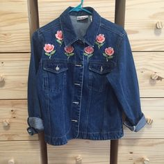 Vintage Floral Embroidered Jean Denim Jacket Denim jacket with pink flower embroidery. Size small straight cut jacket. In perfect condition- like new. Vintage item. One of a kind. Would also fit a medium. Vintage Jackets & Coats Jean Jackets