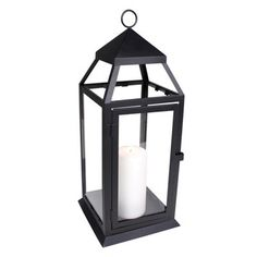 """This medium sized lantern is ideal for a large table, or for hanging by it's hoop. A good size for a small or medium sized pillar candle. 2 3/4"""" x 6"""" pillar shown as an example (not included). Door has a 5 1/4"""" x 10"""" opening..."""