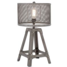 Perfect for an industrial or rustic style home decor. Makes a wonderfully eclectic accent in a modern room, too. Industrial finish metal shade while an intriguing four-leg base is designed to look like an antique piece of hardware.
