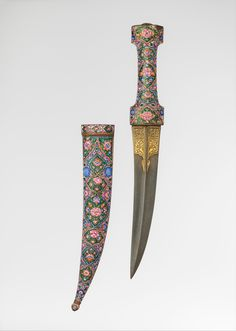 Dagger (Khanjar) with Scabbard.  Date:     late 17th–18th century. Culture:     Iran or Greater Syria. Medium:     Steel, gold, copper, enamel, wood.