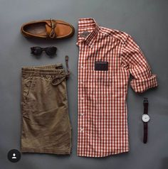 Gingham, rolled sleeves. Loafers.