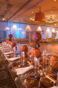 An entire table filled with sports balls from David Tutera for a Bar Mitzvah celebration sports save the dates, baseball save the dates Sports Centerpieces, Bar Mitzvah Centerpieces, Bar Mitzvah Themes, Bar Mitzvah Party, Basketball Party, Sports Party, Basketball Wedding, Basketball Birthday, Basketball Shoes