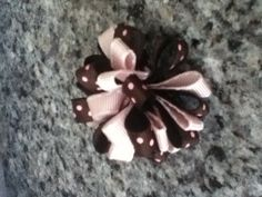 A cute brown and pink bow for your hair