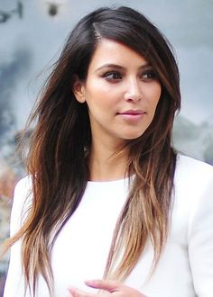 "Reality TV star Kim Kardashian looks chic and stylish with her subtle blonde ombre tips. For a classy and sophisticated ombre hair color, keep the highlighted sections subtle and soft. Color blocking is harsh and brash, so avoid ""lines"" of clashing color and opt for soft, feathered highlights."