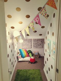 Cute Idea - instead of storing JUNK - make into a cozy under the stairs nook Carpet, lights, cute paint, little furniture, bookshelves, pillows galore.