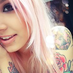 ...I wish I could have those piercings and my hair pink...and look like her!!