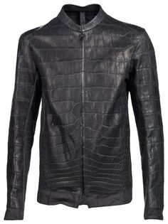 Brutal crocodile jacket in bitume and dark grey from Isaac Sellam. This crocodile skin jacket features a round neckline, front two-way zipper closure, linen trim at sleeves and hem, and linen body and sleeve lining.