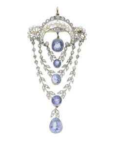 A belle époque sapphire, pearl and diamond brooch, circa 1910  Of garland design, the delicate old brilliant, single and rose-cut diamond surmount with graduated pearl decoration, suspending three articulated swags of various length, each terminating with a cushion-shaped sapphire drop, the whole terminating in a larger pear-shaped sapphire drop, millegrain detail throughout, diamonds approx. 0.95ct. total, some pearls later replaced, length 8.5cm.